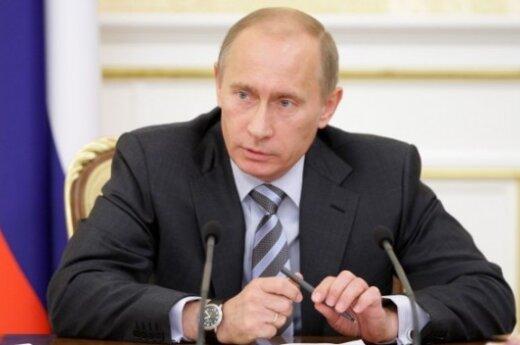 Путин пригласил Туска посетить Катынь