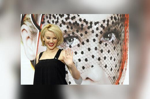"""Australų dainininkė Kylie Minogue pristato savo naujausią albumą """"X""""."""