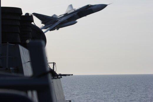 A Russian SU-24 buzzes the USS Donald Cook in the Baltic Sea.