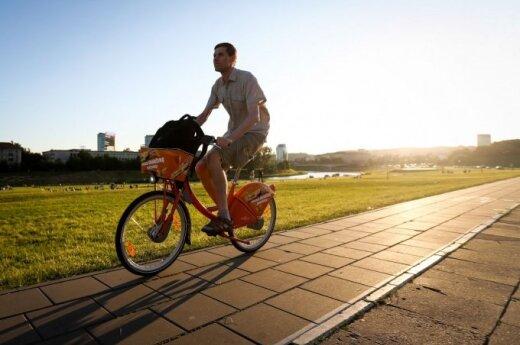 On the Orange Bike in Vilnius on a summer evening