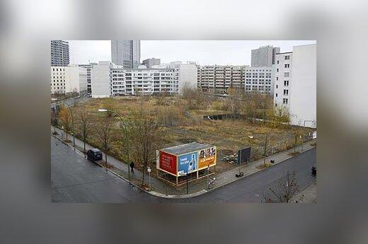 Viešbutis paslėptas už reklaminių stendų