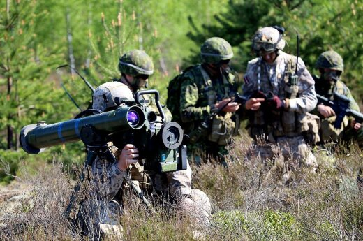 A Latvian soldier, foreground, scans the terrain through the scope of his Spike anti-tank weapon Photo Captain Mark Ruban Public Affairs Officer Operation REASSURANCE Land Task Force