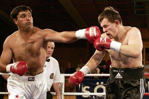 Buvęs pasaulio čempionas Corrie Sandersas (kairėje), 2004 m.